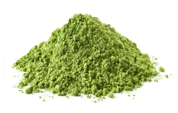 Kratom green powder stack on white background