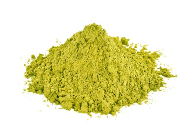 Powder stack of Red Hulu Kratom no background